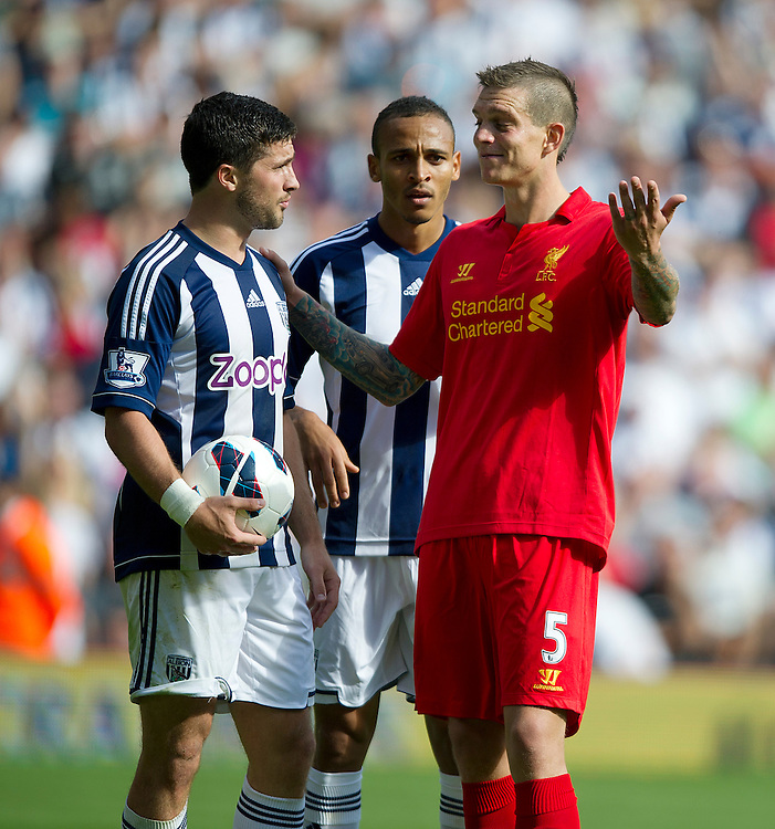 Liverpool's Daniel Agger shows his disbelief to West Bromwich Albion's Shane Long at being shown a red card by Referee Phil Dowd for his tackle the player. Long missed the penalty..Football - Barclays Premiership - West Bromwich Albion v Liverpool - Saturday 18th August 2012 - The Hawthorns - West Bromwich..