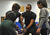 Nikken Fauntleroy, center, coaches female wrestlers Lisauri Almanzar, a junior and varsity wrestler at Amityville High School, left, and Copiague seventh grader Stacey Rosado at Copiague High School on Tuesday, Jan. 31, 2017.