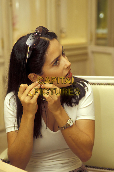 SALMA HAYEK.04 July 2001.portrait headshot trying on earings white t shirt.ref:10958.www.capitalpictures.com.sales@capitalpictures.com.©Capital Pictures