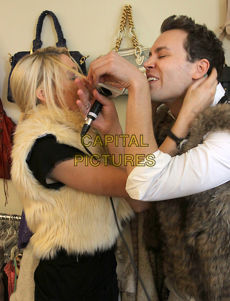 "STEPHANIE PRATT & MATTHEW HOFFMAN.Hollyscoop.com Closet Raiders with ""The Hills"" Stephanie Pratt held At A Private Residence, Pacific Palisades, California, USA..September 28th, 2009.half length black top brown cream white  gilet fur funny profile hair.CAP/ADM/KB.©Kevan Brooks/AdMedia/Capital Pictures."