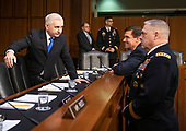 """United States Senator Jack Reed (Democrat of Rhode Island), left, converses with US Secretary of the Army Dr. Mark T. Esper, second right, and US Army General Mark A. Milley, Chief of Staff of the Army, right, prior to the hearing before the US Senate Committee on Armed Services during a hearing on """"Chain of Command's Accountability to Provide Safe Military Housing and Other Building Infrastructure to Service members and Their Families"""" on Capitol Hill in Washington, DC on Thursday, March 7, 2019.<br /> Credit: Ron Sachs / CNP"""