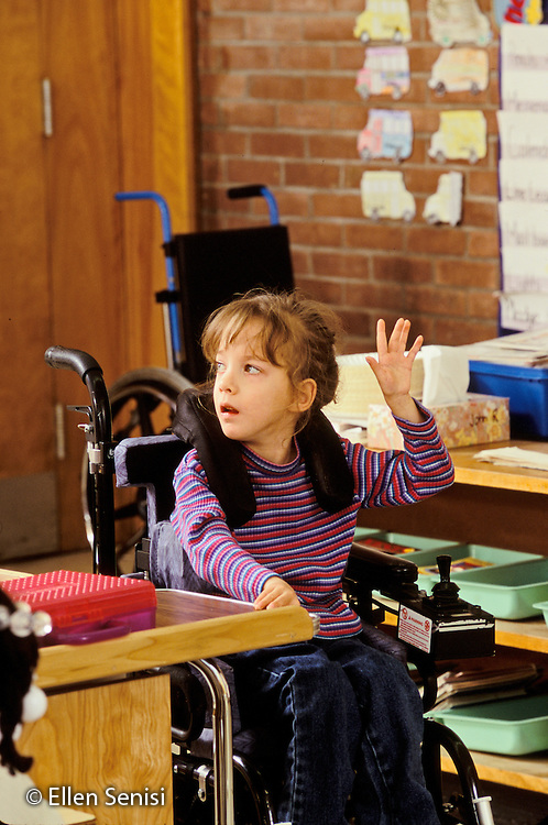 MR / Schenectady, NY.Zoller Public School - Inclusion Class - Grade 1.Girl (6, cerebral palsy) raises hand to participate in class..MR: Her4.PN#: 28445                     FC#:  21651-00813.scan from slide.© Ellen B. Senisi