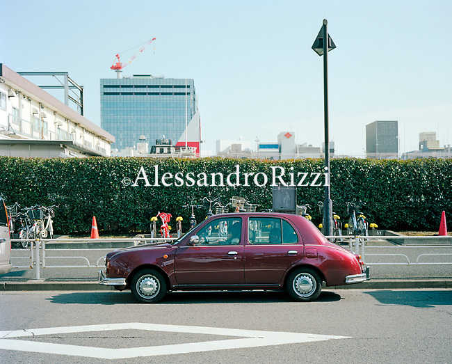 Frontal view of a car in Tokyo