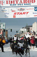 Charley Bejna and team leave the ceremonial start line with an Iditarider at 4th Avenue and D Street in downtown Anchorage, Alaska on Saturday, March 5th during the 2016 Iditarod race. Photo by Joshua Borough/SchultzPhoto.com