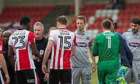 The sides shake hands ahead of the Sky Bet League 2 match between Cheltenham Town and Grimsby Town at the The LCI Rail Stadium,  Cheltenham, England on 17 April 2017. Photo by PRiME Media Images / Mark Hawkins.