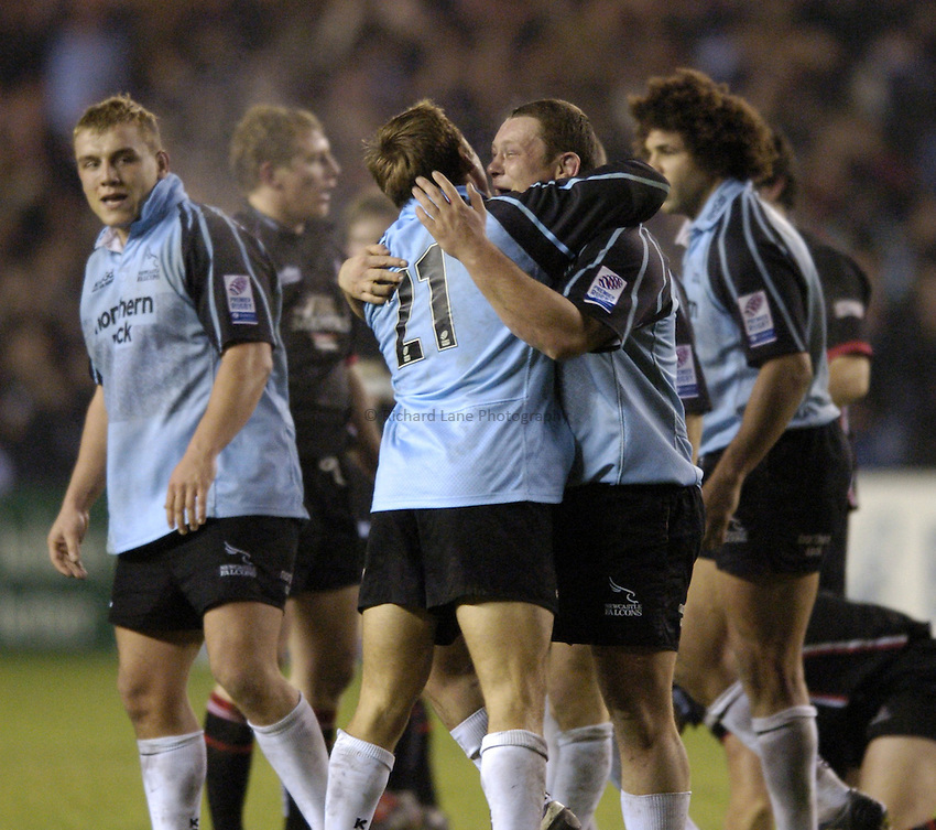 Photo. Jed Wee..Edinburgh Rugby v Newcastle Falcons , Heineken Cup, 11/12/2004..Newcastle's Micky Ward celebrates with Jonny Wilkinson, as Matt Thompson (L) looks on.