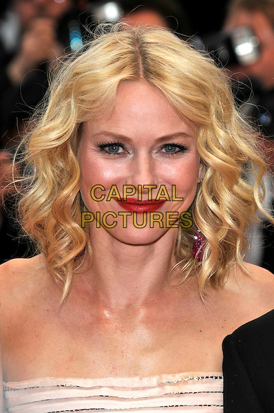 NAOMI WATTS .Attending the screening of 'You Will Meet a Tall Dark Stranger' presented out of competition at the 63rd Cannes Film Festival, Cannes, France, .15th May 2010..premiere portrait headshot red lipstick make-up strapless wavy hair eye contact .CAP/PL.©Phil Loftus/Capital Pictures.