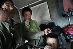 A muslim family still living in one of the small tents provided after the earthquake in Yushu.