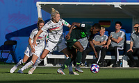 GRENOBLE, FRANCE - JUNE 22: Lea Schueller #7 of the German National Team, Chidinma Okeke #20 of the Nigerian National Team battle for the ball during a game between Nigeria and Germany at Stade des Alpes on June 22, 2019 in Grenoble, France.