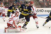 Sean Maguire (BU - 31), Derek Petti (Merrimack - 10), Brandon Hickey (BU - 4) - The Boston University Terriers defeated the visiting Merrimack College Warriors 4-0 (EN) on Friday, January 29, 2016, at Agganis Arena in Boston, Massachusetts.