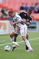 DC United defender Jordan Graye (16) fights for possession of the ball against Kansas City Wizards midfielder Ryan Smith (11).  DC United defeated The Kansas City Wizards  2-0 at RFK Stadium, Wednesday  May 5, 2010.