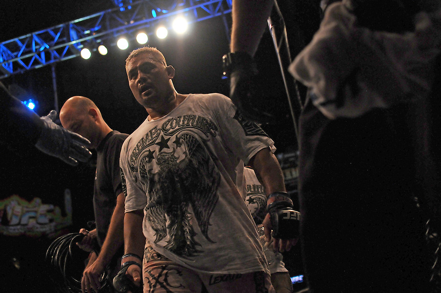 24 SEPTEMBER 2011:   Mark HUnt leaves the octagon after beating Ben Rothwell  during UFC 135 at the Pepsi Center in Denver, Colorado. *****For Editorial Use Only*****