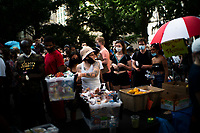 NEW YORK, NEW YORK - June 25: People try to get food as they take part in a protest encampment near NYC City hall on June 25, 2020 in New York, NY. Demonstrators are calling for $1 billion in cuts of NYPD, as they protest encampment near City Hall and NYPD headquarters ahead of the city July 1 budget deadline.  (Photo by Eduardo MunozAlvarez/VIEWpress)