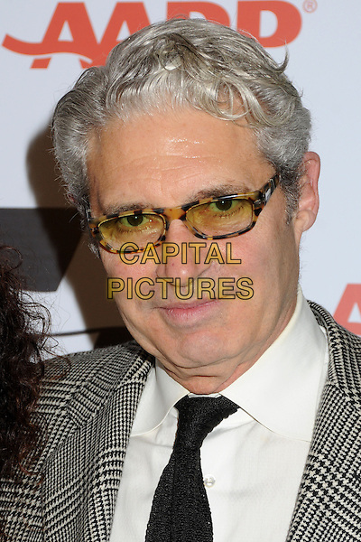 Michael Nouri.AARP Movies For Grownups Awards Luncheon held at The Peninsula Hotel, Beverly Hills, California, USA..February 12th, 2013.headshot portrait glasses black white shirt grey gray  .CAP/ADM/BP.©Byron Purvis/AdMedia/Capital Pictures.