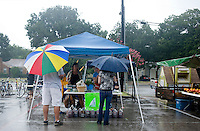 Despite heavy rain, customers and vendors came out on a Saturday morning to the White Rock Lake Farmers Market in Dallas, Texas, USA, Sept. 12, 2009. Growing produce or buying locally grown vegetables and canning at home is a fun and healthy way to keep grocery costs down...CREDIT: Matt Nager for The Wall Street Journal