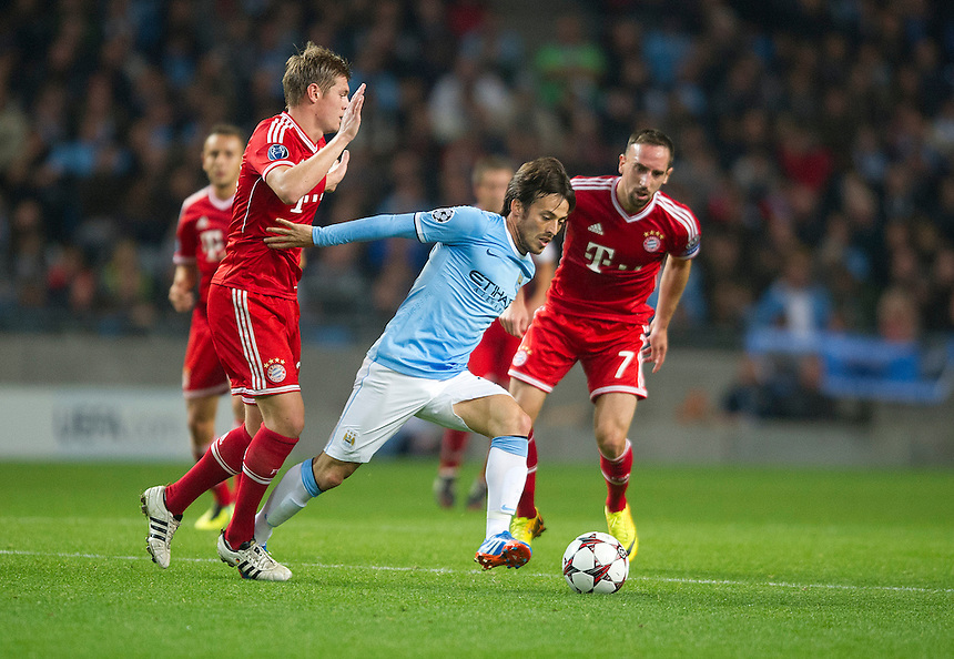 Manchester City's David Silva holds off the challenge from Bayern Munich's Toni Kroos (L) and Franck Ribery<br /> <br /> Photo by Stephen White/CameraSport<br /> <br /> Football - UEFA Champions League Group D - Manchester City v Bayern Munich - Wednesday 2nd October 2013 -  Etihad Stadium - Manchester<br /> <br /> &copy; CameraSport - 43 Linden Ave. Countesthorpe. Leicester. England. LE8 5PG - Tel: +44 (0) 116 277 4147 - admin@camerasport.com - www.camerasport.com