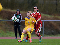 20150404 - FORST , GERMANY  : Ukrainian Alona Komanda pictured defending the ball for Belgian Jody Vangheluwe (right) during the soccer match between Women Under 19 teams of Belgium and Ukraine , on the first matchday in group 5 of the UEFA Elite Round Women Under 19 at WaldseeStadion , Forst , Germany . Saturday 4th April 2015 . PHOTO DAVID CATRY