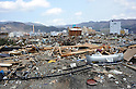 April 2nd, 2011, Ofunato, Japan - A field of debris stretches in foreground in Ofunato City, Iwate Prefecture, on April 2, 2011, three weeks after this northeastern Japanese fishing port nestled deep inside an inlet was destroyed by a magnitude 9.0 earthquake and ensuing tsunami. (Photo by Natsuki Sakai/AFLO) [3615] -mis-...