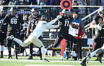 SIOUX FALLS, SD, NOVEMBER 26:  Kyle Groeneweg #11 from the University of Sioux Falls is pushed out of bounds on the opening kickoff by Frank Herbert #21 from Harding University Saturday afternoon at Bob Young Field in Sioux Falls. (Photo by Dave Eggen/Inertia)