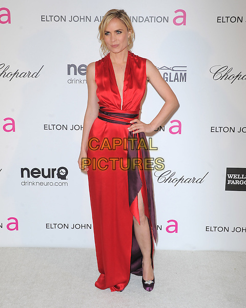 Radha Mitchell.The 21st Annual Elton John AIDS Foundation Academy Awards Viewing Party held at The City of West Hollywood Park in West Hollywood, California, USA..February 24th, 2013.oscars full length dress slit split purple waistband red silk satin sleeveless hand on hip.CAP/DVS.©DVS/Capital Pictures.