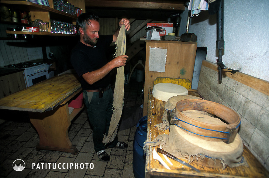 Traditional Swiss cheese making technique in the Swiss Alps. Blackenalp, Engelberg, Switzerland