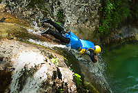 Julian Alps, Slovenia, July 2011. Canyoning through the gorges, abseiling and jumping from pool to pool and through waterfalls. Slovenia boast a very spectacular carstic landscape with high limestone rock formations oozing with waterfalls, and fast flowing cristal clear waters that run through the Soca from the Triglav National Park to the Adriatic Sea. The Julian Alps are a paradise for outdoor adventure and adrenaline sports. The 3 centers for all activities are Bovec, Kobarid and Tolmin.  Photo by Frits Meyst/Adventure4ever.com
