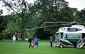 United States President Barack Obama with daughter Sasha Obama and first lady Michelle Obama walks from Marine One on the South Lawn of the White House, Sunday, August 15, 2010 in Washington, DC.  President Obama was returning from the Gulf Coast where he stayed in Panama City Beach, Florida with first lady Michelle Obama and their daughter Sasha for an overnight trip to the region which has been affected by the BP oil spill from the sinking of the Deep Water Horizon drilling platform. .Credit: Brendan Smialowski - Pool via CNP