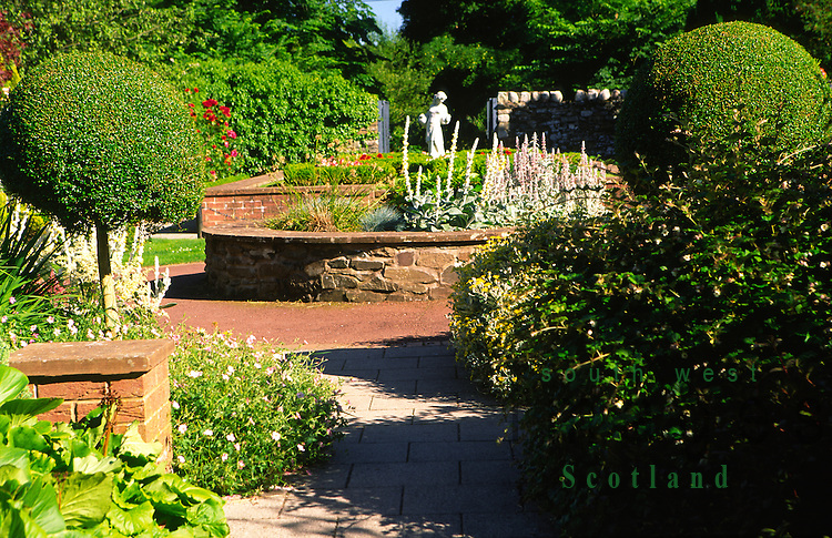 Gatehouse of Fleet small garden just of Fleet Street in town centre catching the summer evening sunshine Galloway Scotland UK