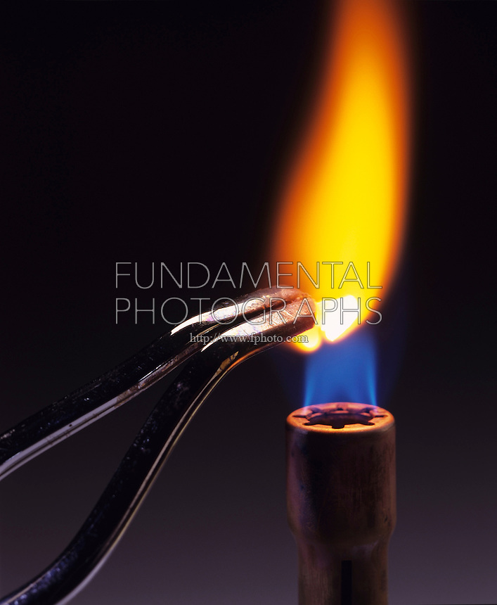 CALCIUM FLAME TEST<br /> Bright flame (4 of 4)<br /> Calcium metal is held over Bunsen burner and burns with bright orange flame.