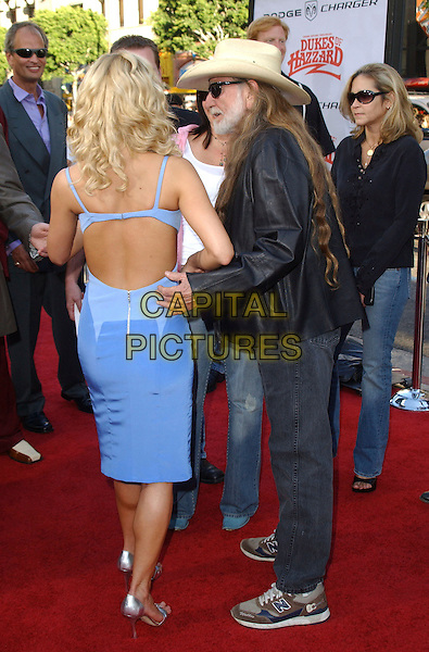 "JESSICA SIMPSON & WILLIE NELSON.The Warner Brothers World Premiere of ""The Dukes of Hazzard"" held at The Grauman's Chinese Theatre in Hollywood, California  .July 28th, 2005.full length cowboy hat stetson black leather jacket jeans denim blue dress backless back behind rear.www.capitalpictures.com.sales@capitalpictures.com.Supplied By Capital PIctures"