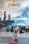 Manhattan, New York City, New York, USA. October 10, 2015. A cosplayer with a large pink paint roller poses in front of wall covered by banner for The Shannara Chronicles, a new fantasy adventure series by MTV, premiering January 2016, at the 10th Annual New York Comic Con. NYCC 2015 is expected to be the biggest one ever, with over 160,000 attending during the 4 day ReedPOP event, from October 8 through Oct 11, at Javits Center in Manhattan