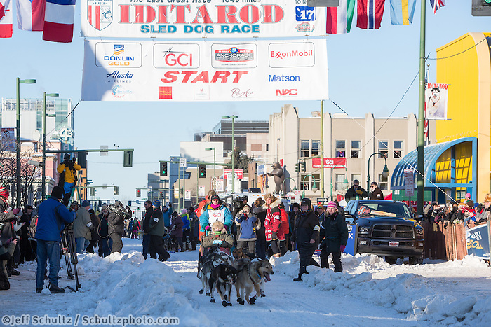 Misha Wiljes and team leave the ceremonial start line with an Iditarider and handler at 4th Avenue and D street in downtown Anchorage, Alaska on Saturday March 4th during the 2017 Iditarod race. Photo © 2017 by Brendan Smith/SchultzPhoto.com.