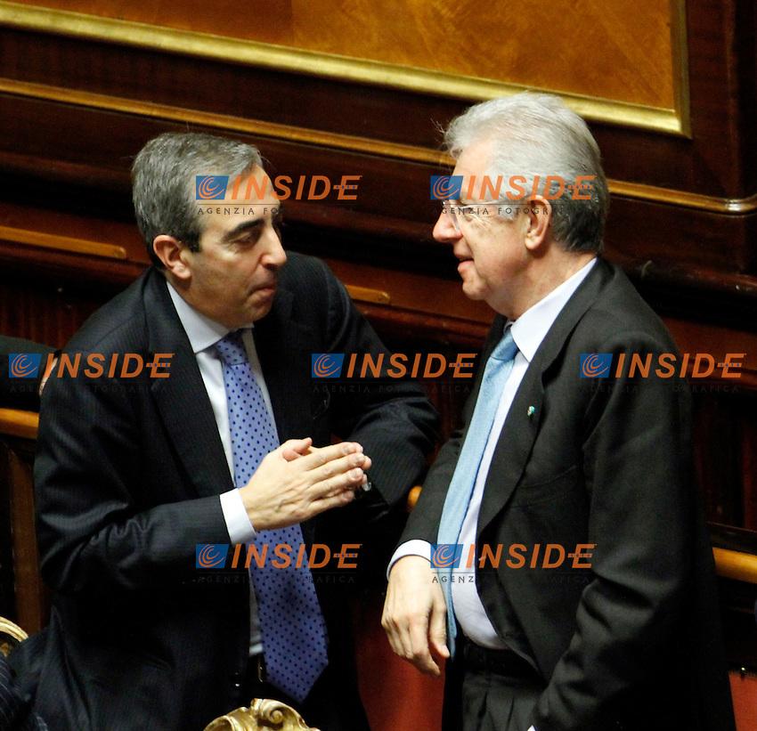 MAURIZIO GASPARRI E MARIO MONTI.Roma 22/12/2011 Senato. Voto di Fiducia sulla Manovra Economica.Votation at Senate about austerity plan. .Photo Samantha Zucchi Insidefoto