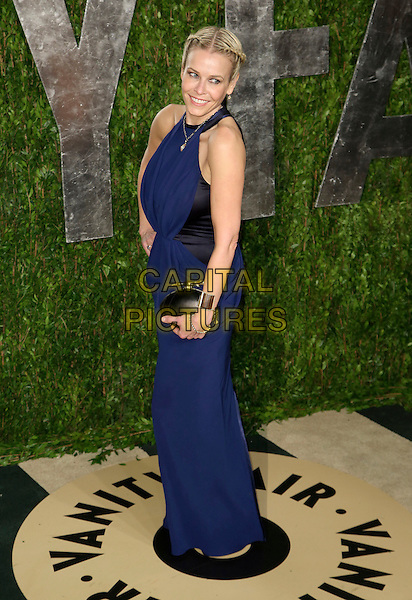 Chelsea Handler.2013 Vanity Fair Oscar Party following the 85th Academy Awards held at the Sunset Tower Hotel, West Hollywood, California, USA..February 24th, 2013.oscars full length blue black sleeveless dress clutch bag side .CAP/ADM/SLP/DOW.©Dowling/StarlitePics/AdMedia/Capital Pictures