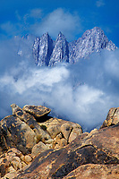 711700052 mount whitney rises out of clearing storm clouds above the granite boulders of blm protected alabama hills lands eastern sierras california