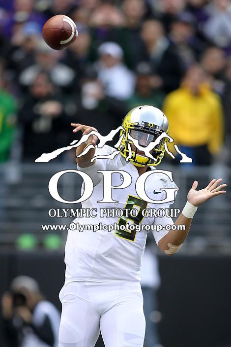 2013-10-12: Oregon's Marcus Mariota fires the ball down field against Washington.  Oregon won 45-24 over Washington in Seattle, WA.