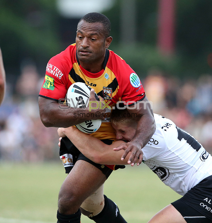 PICTURE BY PAUL SEISER/SWPIX.COM - Rugby League - NRL Preseason - Return to Redfern 2013 - South Sydney Rabbitohs v Papua New Guinea - Redfern Oval, Sydney, Australia - 09/02/13 - PNG's Glen Nami.