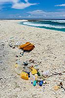 pollution, marine debris or marine litter, plastic wastes on coral rubble beach, Clipperton Island, Overseas France, Pacific Ocean