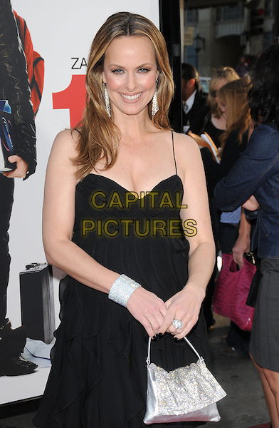 "MELORA HARDIN.The L.A. premiere of ""17 Again"" held at The Grauman's Chinese Theatre in Hollywood, California, USA. .April 14th, 2009.half length dress silver bag purse bracelet cuff ring dangling diamante earrings cleavage black .CAP/DVS.©Debbie VanStory/Capital Pictures."