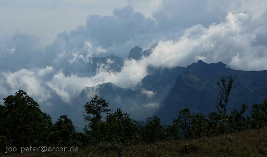 vulcano shaped landscape in clouds and fog, near Wawo Muda vulcano, island  Flores in archipelago of Indonesia