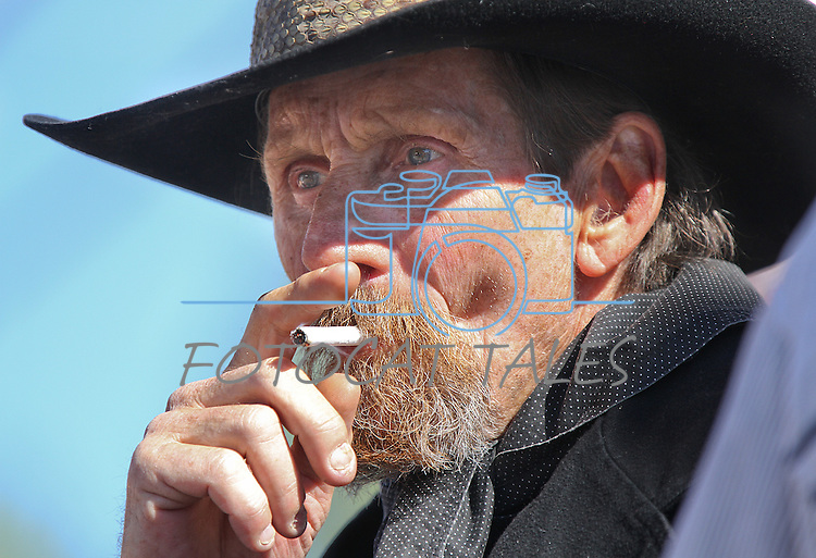 """Richard Fladland, with Gunslingers of Nevada, whose character name is """"Rattlesnake Dick,"""" watches the Dayton Valley Days parade in Dayton, Nev., on Saturday, Sept. 18, 2010..Photo by Cathleen Allison"""