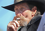 "Richard Fladland, with Gunslingers of Nevada, whose character name is ""Rattlesnake Dick,"" watches the Dayton Valley Days parade in Dayton, Nev., on Saturday, Sept. 18, 2010..Photo by Cathleen Allison"