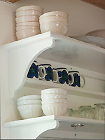 Open shelving was chosen as a more visually pleasing storage solution for crockery, when the kitchen was remodelled