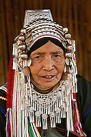 Akha hilltribe woman wearing ornate headress, northern Thailand near Chiang Rai.