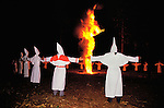 Members of the Invisible Empire of the Knights of the Klu Klux Klan light a cross during their ceremony in Gadsden County, Florida north of Tallahassee May 26,1990.