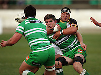 Manawatu lock Mike Fitzgerald passes to Francis Bryant in the tackle of Arden David-Perrot during the Air NZ Cup preseason match between Manawatu Turbos and Wellington Lions at FMG Stadium, Palmerston North, New Zealand on Friday, 17 July 2009. Photo: Dave Lintott / lintottphoto.co.nz