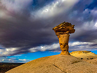 The Secret Spire and looming clouds, Green River canyons, near Moab, Utah