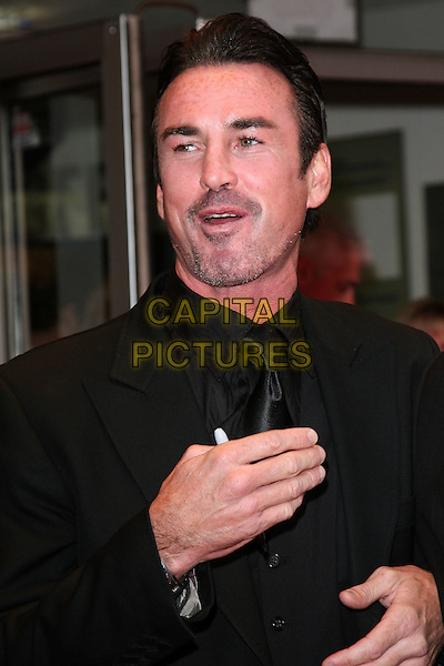 GARY STRETCH .World Premiere of 'The Heavy' at the Odeon West End, Leicester Square, London, England, UK, April 15th 2010.arrivals half length hand black mouth open suit tie shirt  stubble facial hair .CAP/ROS.©Steve Ross/Capital Pictures.