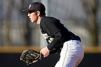 First baseman Matt Conway #25 of the Wake Forest Demon Deacons on defense at the Wake Forest Baseball Park March 6, 2010, in Winston-Salem, NC.  Photo by Brian Westerholt / Four Seam Images