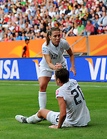 Abby Wambach (r) and Lauren Cheney of Team USA during the FIFA Women's World Cup at the FIFA Stadium in Sinsheim, Germany on July 2nd, 2011.